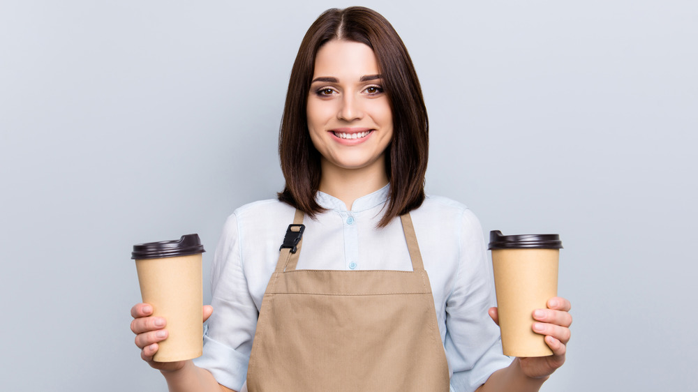 barista holding coffee cups