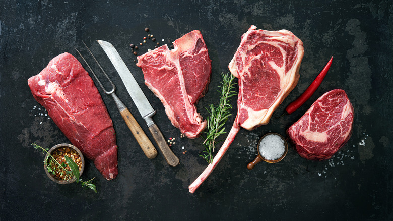 Red meat steaks on a table