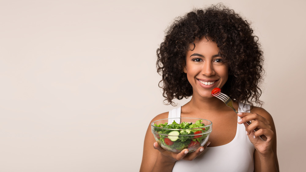 Woman eating and looking happy