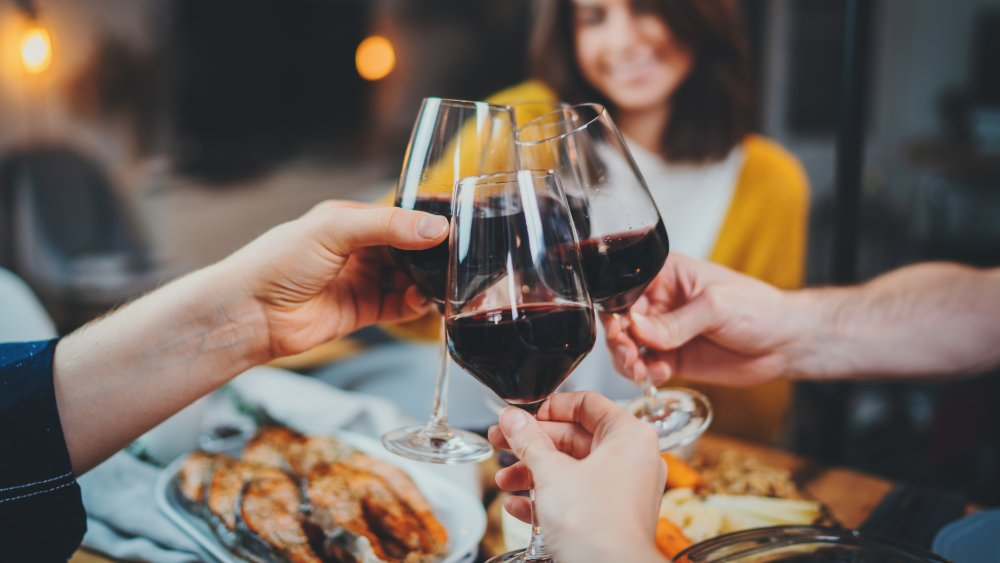 friends drinking wine with a meal