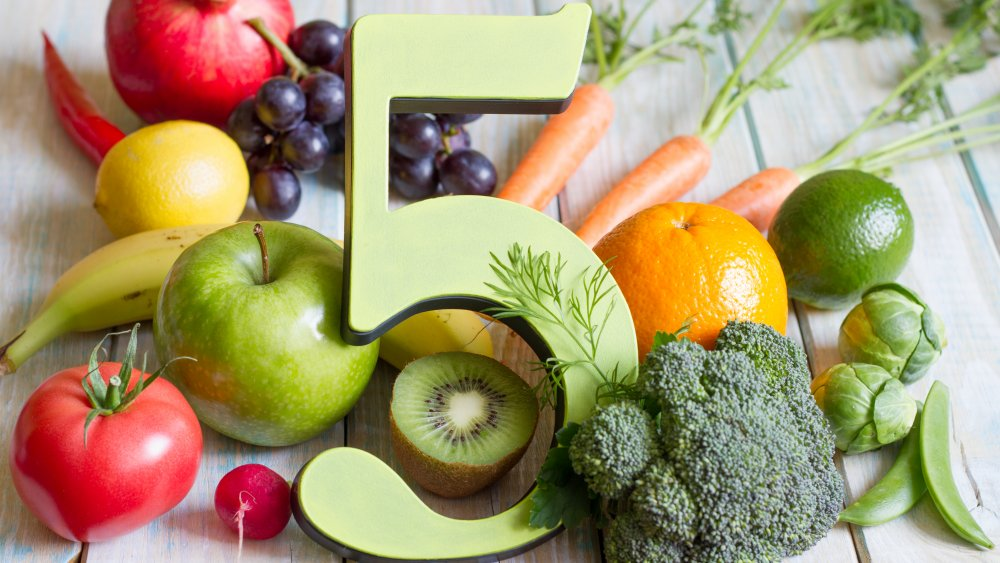 The number 5 in a pile of fruits and vegetables